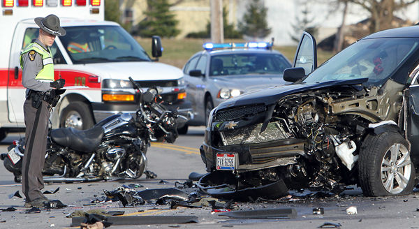 Ohio State Highway patrolman investigates the scene of a double fatal car accident